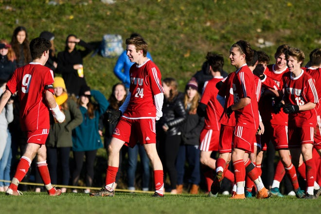 CVU celebrates a goal during the boys soccer semifinal game between The Burlington Sea Horses and the Champlain Valley Union Redhawks at CVU High School on Tuesday afternoon October 30, 2018 in Hinesburg.