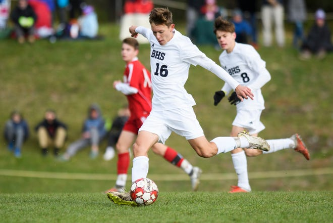 Burlington's Jake Manley (16) kicks the ball down the field during the boys soccer semifinal game between The Burlington Sea Horses and the Champlain Valley Union Redhawks at CVU High School on Tuesday afternoon October 30, 2018 in Hinesburg.