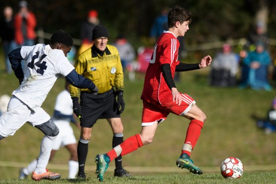 CVU's Jack Sinopoli (30) runs downtime field with the ball during the boys soccer semifinal game between The Burlington Sea Horses and the Champlain Valley Union Redhawks at CVU High School on Tuesday afternoon October 30, 2018 in Hinesburg.