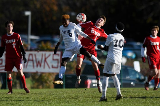 CVU's Caleb Martin (11) and Burlington's Byaombe Shukura (9) leap to head the ball during the boys soccer semifinal game between The Burlington Sea Horses and the Champlain Valley Union Redhawks at CVU High School on Tuesday afternoon October 30, 2018 in Hinesburg.