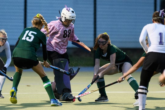 Bellows Falls goalie Emma Lober (88) makes a save during the semifinal field hockey game between the Rice Green Knights and the Bellows Falls Terriers at Middlebury College on Oct. 29.