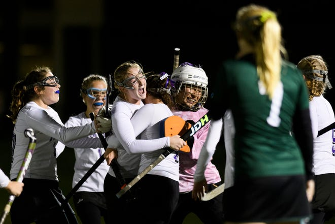 Bellows Falls celebrates the win during the semifinal field hockey game between the Rice Green Knights and the Bellows Falls Terriers at Middlebury College on Monday afternoon October 29, 2018 in Middlebury.