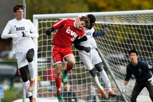 CVU's Jack Sinopoloi (30) and Burlington's Hussein Mubarak (14) battle to head the ball during the boys soccer semifinal game between The Burlington Sea Horses and the Champlain Valley Union Redhawks at CVU High School on Tuesday afternoon October 30, 2018 in Hinesburg.