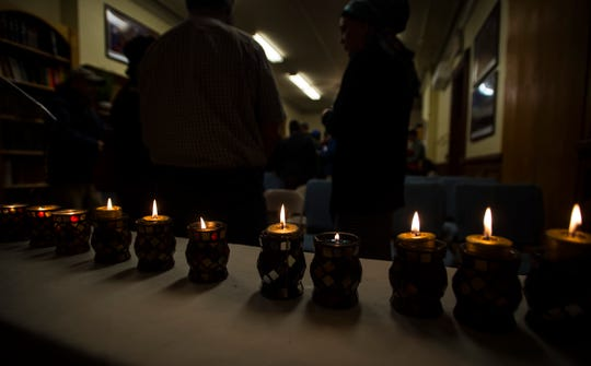 Eleven candles, one marking each life of the people killed at the Tree of Life Congregation Synagogue in the Squirrel Hill neighborhood of Pittsburgh, were lit during a vigil at Chabad of Vermont in Burlington on Monday night, Oct. 29, 2018.