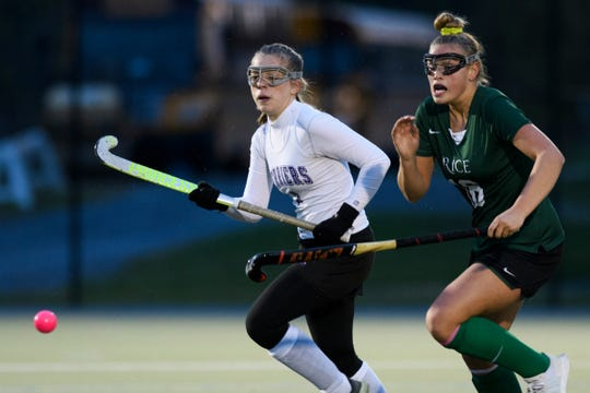Bellows Falls' Meagan Kelly (3) and Rice's Kate Buckley (16) chase down the ball during the semifinal field hockey game between the Rice Green Knights and the Bellows Falls Terriers at Middlebury College on Monday afternoon October 29, 2018 in Middlebury.