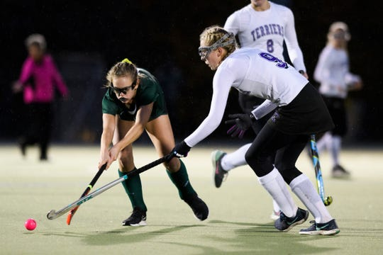 Rice's Amy Hester, left, battles for the ball during a 2018 Division I high school field hockey semifinal game vs. Bellows Falls.