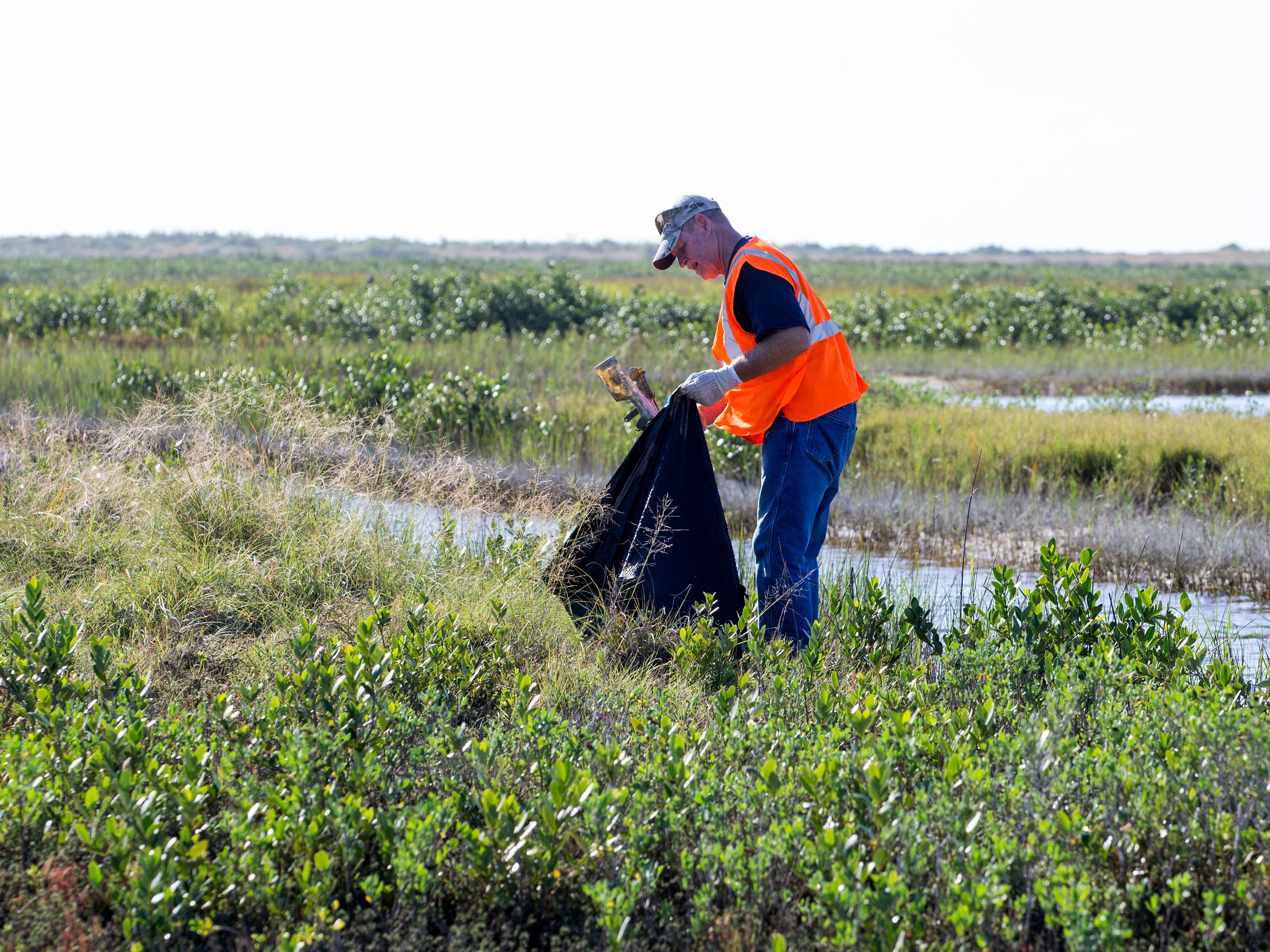 Bob Schantz cleans up Cove Harbor Wetlands Sanctuary in Aransas County on Tuesday, October 30, 2018 during a cleanup organized by Keep Aransas County Beautiful.Volunteers were working to clean debris from the wetlands and harbor that was scattered by Hurricane Harvey over 14 months ago.