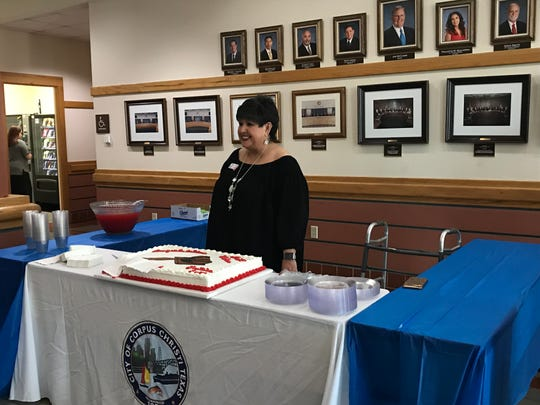 Corpus Christi Councilwoman Lucy Rubio stands behind a going-away cake that was vandalized before she had a chance to cut it on Tuesday, Oct. 30, 2018. A report was filed by Corpus Christi police soon after.