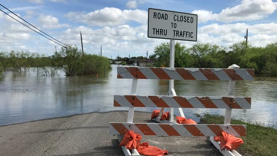Nueces County officials set up road blocks on County Road 73 near Rock Island Drive because of flooding from the Nueces River on Tuesday, Oct. 30, 2018.