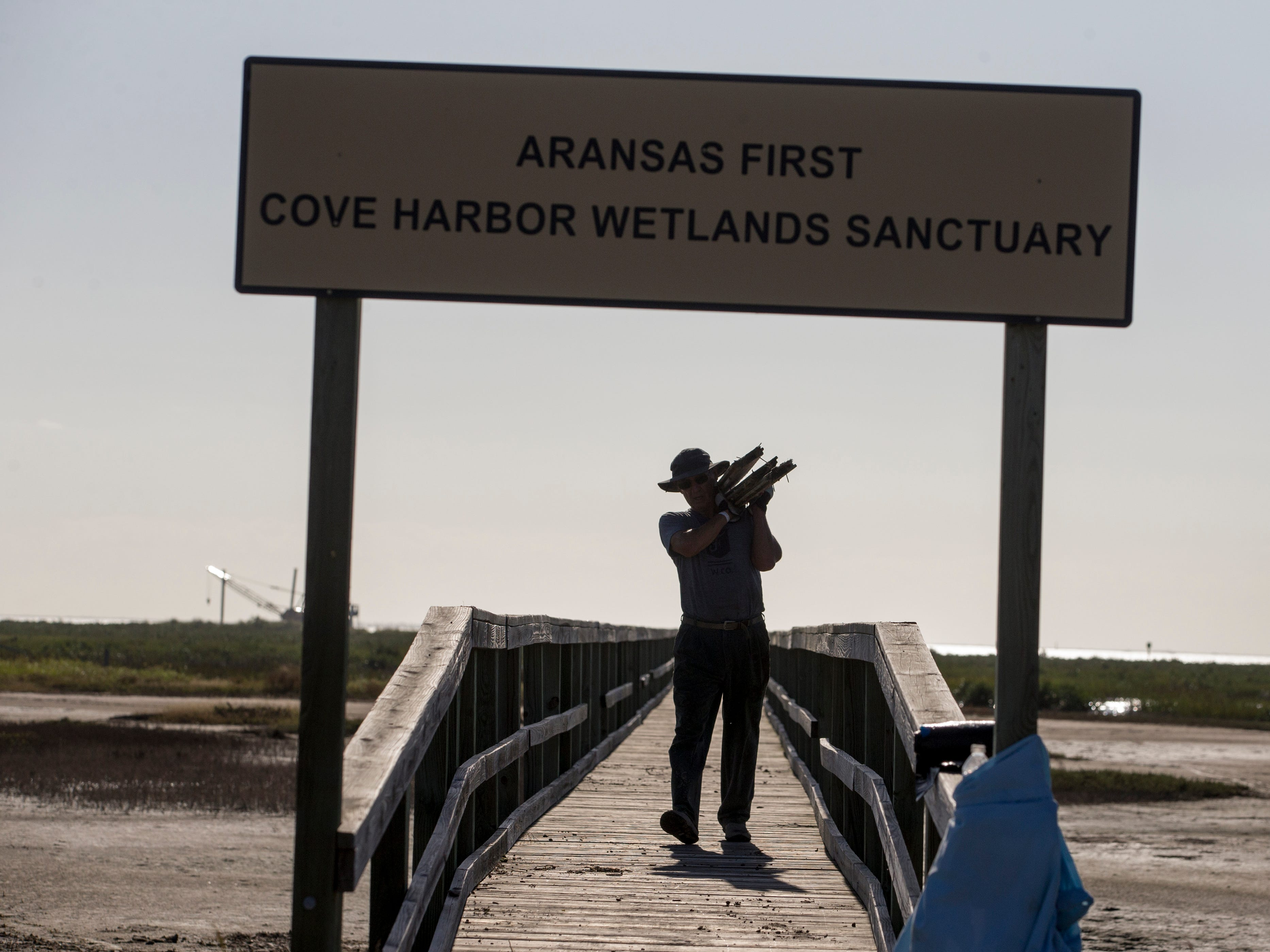 Ronnie Wotipka cleans up Cove Harbor Wetlands Sanctuary in Aransas County on Tuesday, October 30, 2018 during a cleanup organized by Keep Aransas County Beautiful.Volunteers were working to clean debris from the wetlands and harbor that was scattered by Hurricane Harvey over 14 months ago.