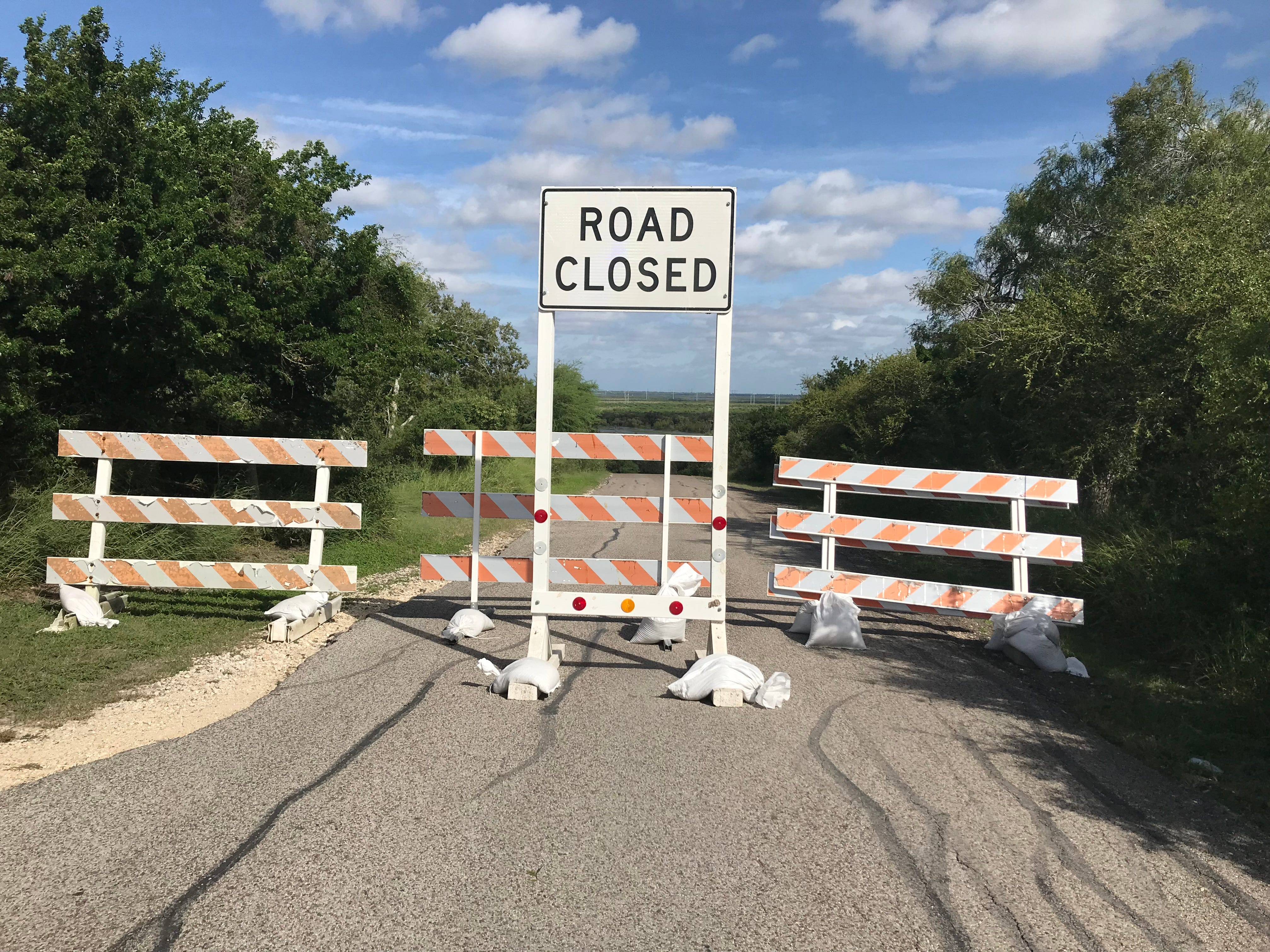 Roads leading down to Hazel Bazemore Park in Corpus Christi were blocked Tuesday, Oct. 30, 2018. Water from the Nueces River began to rise in the park.