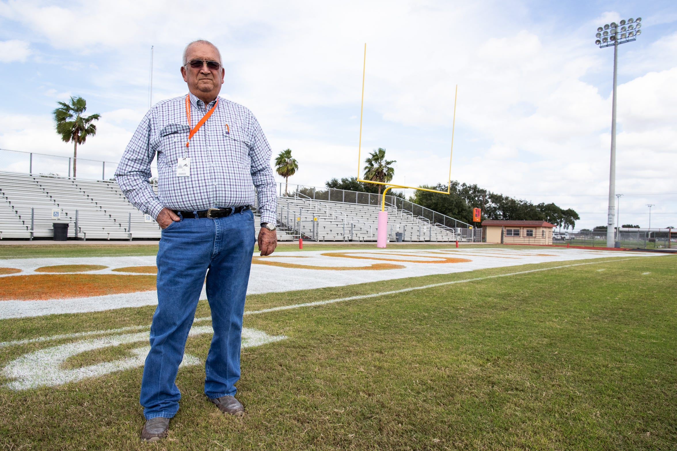 Billy Riojas grounds keeper at the Alice High School's Coyote Stadium stands for a photo.