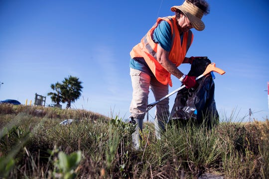 Mary Griffin cleans up Cove Harbor Wetlands Sanctuary in Aransas County on Tuesday, October 30, 2018 during a cleanup organized by Keep Aransas County Beautiful.Volunteers were working to clean debris from the wetlands and harbor that was scattered by Hurricane Harvey over 14 months ago.