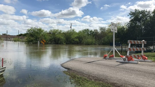 A portion of County Road 73 near Rock Island Drive is covered by water. A road block was also set up by Nueces County officials on Tuesday, Oct. 30, 2018.