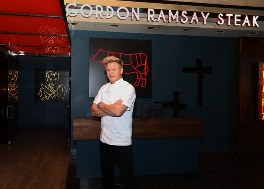 Gordon Ramsay stands in front of Gordon Ramsay Steak at Harrah's in Atlantic City.