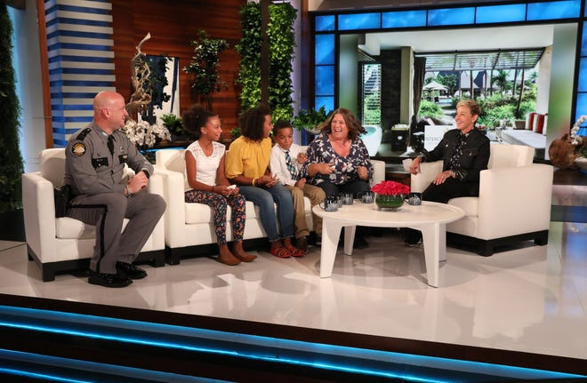 Ellen DeGeneres talks to Koeberle Bull (right on couch) of Lumberton, her three children and Kentucky State Police Trooper Josh Satterly about Bull's call that stopped a potential school shooting.