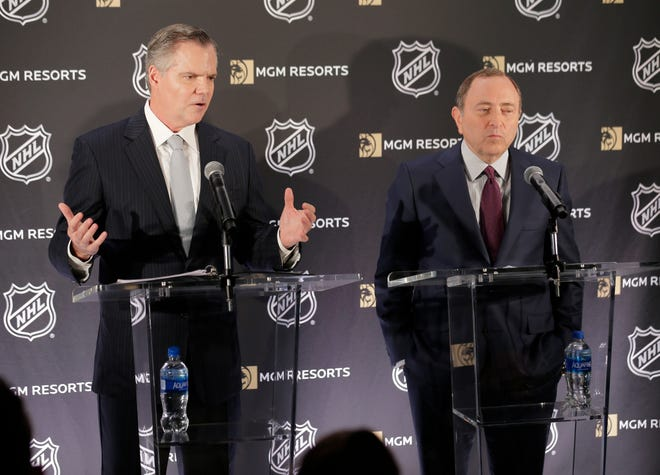 National Hockey League commissioner Gary Bettman, right, and James Murren, CEO of MGM Resorts International, participate in a news conference in New York, Monday.