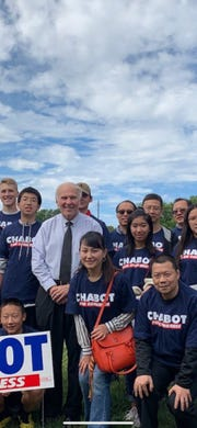 Jack Dohrenwend is standing behind Congressman Steve Chabot, wearing the tan ball cap, at a Sept. 23 campaign for the Republican lawmaker.