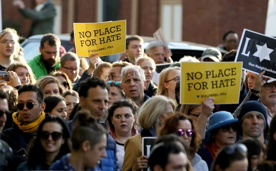 """Over a thousand protesters march through the Squirrel Hill Neighborhood of Pittsburgh Tuesday, October 30, 2018, during the """"Stand together in solidarity with the Pittsburgh Jewish Community."""""""
