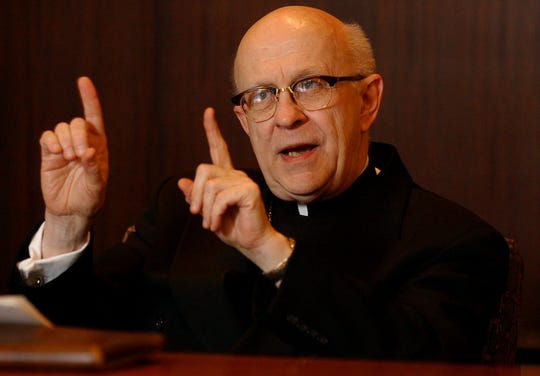 Archbishop Daniel Pilarczyk during an interview with the Cincinnati Enquirer editorial board in 2002.