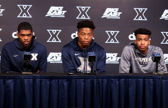 From left: Xavier University Musketeers players Naji Marshall, Tyrique Jones and Paul Scruggs answer questions during a press conference, Tuesday, Oct. 30, 2018, at Cintas Center in Cincinnati.