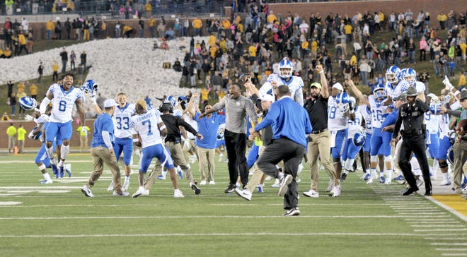 Kentucky Wildcats players celebrate after the win over the Missouri Tigers at Memorial Stadium/Faurot Field. Kentucky won 15-14.