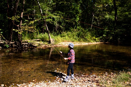 Jen Ripple casts the line back and fourth while fly fishing  Oct. 12, 2018, in Dover, Tenn.
