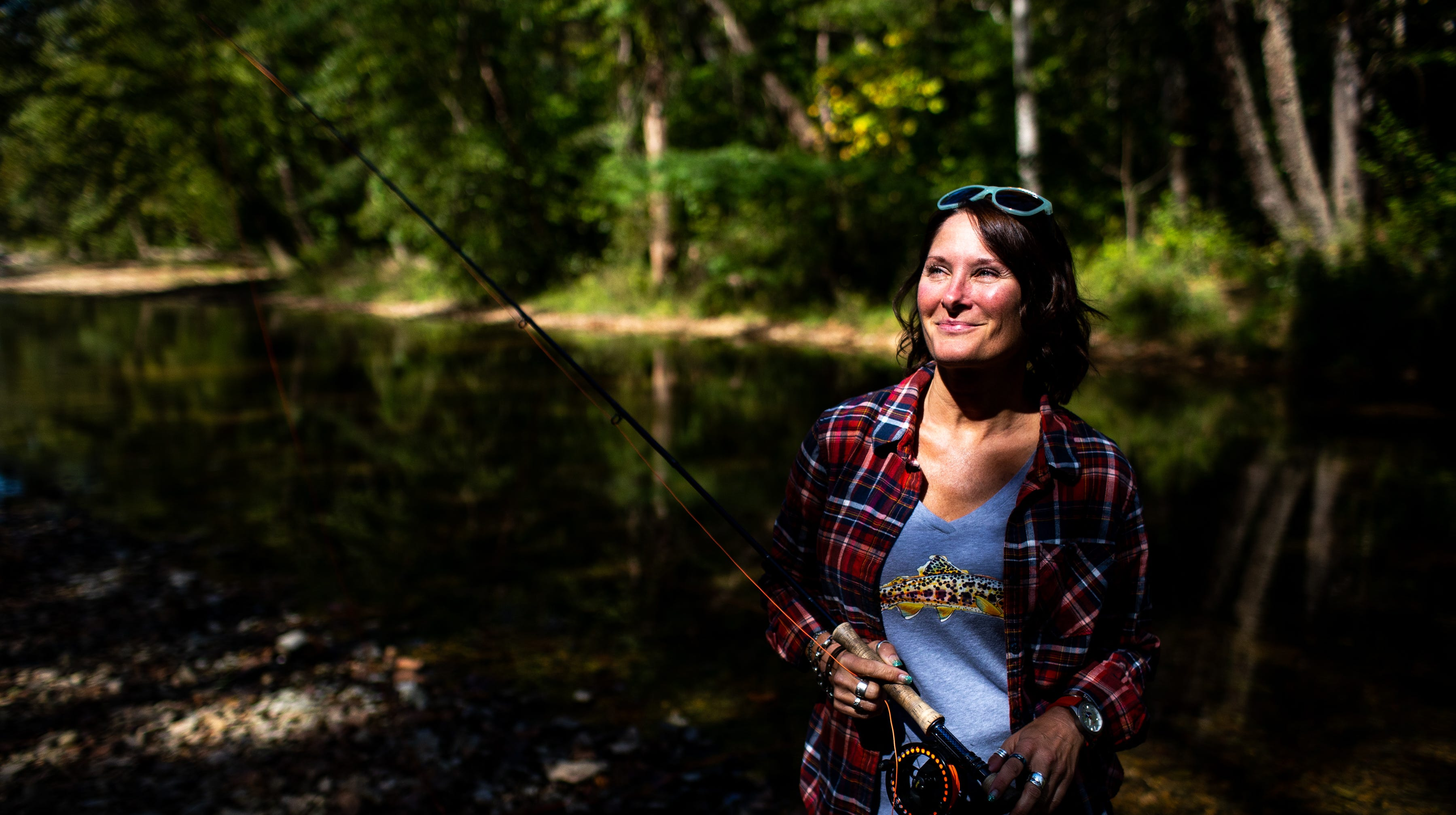 Jen Ripple poses for a portrait with her fly fishing rod Friday, Oct. 12, 2018, in Dover, Tenn.