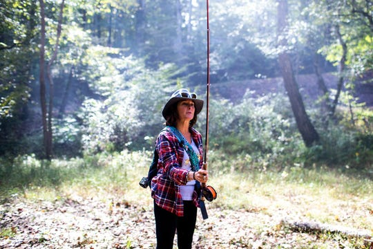 Jen Ripple demonstrates how to cast while fly fishing Friday, Oct. 12, 2018, in Dover, Tenn.