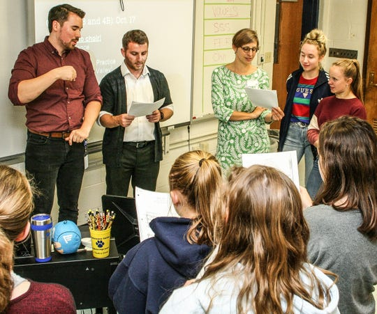 Working to get the German lyrics pronounced correctly are, from left, Del Val teachers Dan Wells and Ben McPherson; and three visitors from Germany – teacher Lisa Pink and students Josephine Munn and Nimue Eisenkolb.