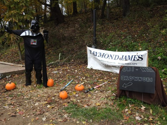 Raymond James Financial won the Scarecrow Trail contest at Clary Gardens for a Stars Wars themed display featuring Darth Vader.