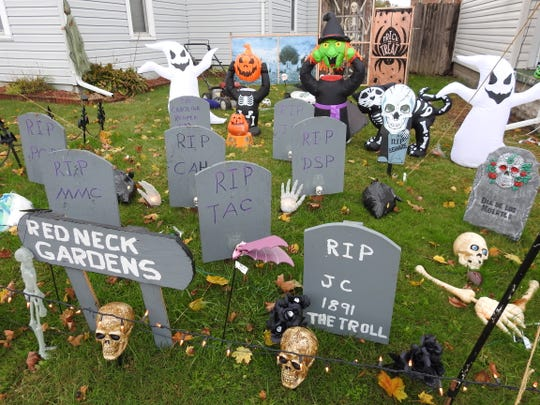 Cindy Hughes and Matt Cornelius have decorated their East Main Street home for Halloween with several inflatables and some homemade decorations, like tombstones for a graveyard.