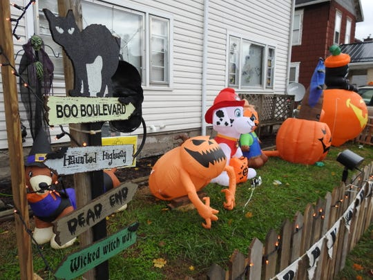 Several inflatables and some homemade decorations, like tombstones for a graveyard, dot the yard at 1010 East Main St.