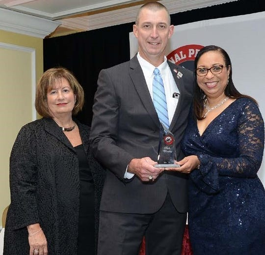 Charles Rinkes of River View High School, center, receives the State Principal of the Year Award from the National Association of Secondary School Principals President Christine Handy and Executive Director JoAnn Bartoletti during the association's recent Principals Institute in Washington D.C.