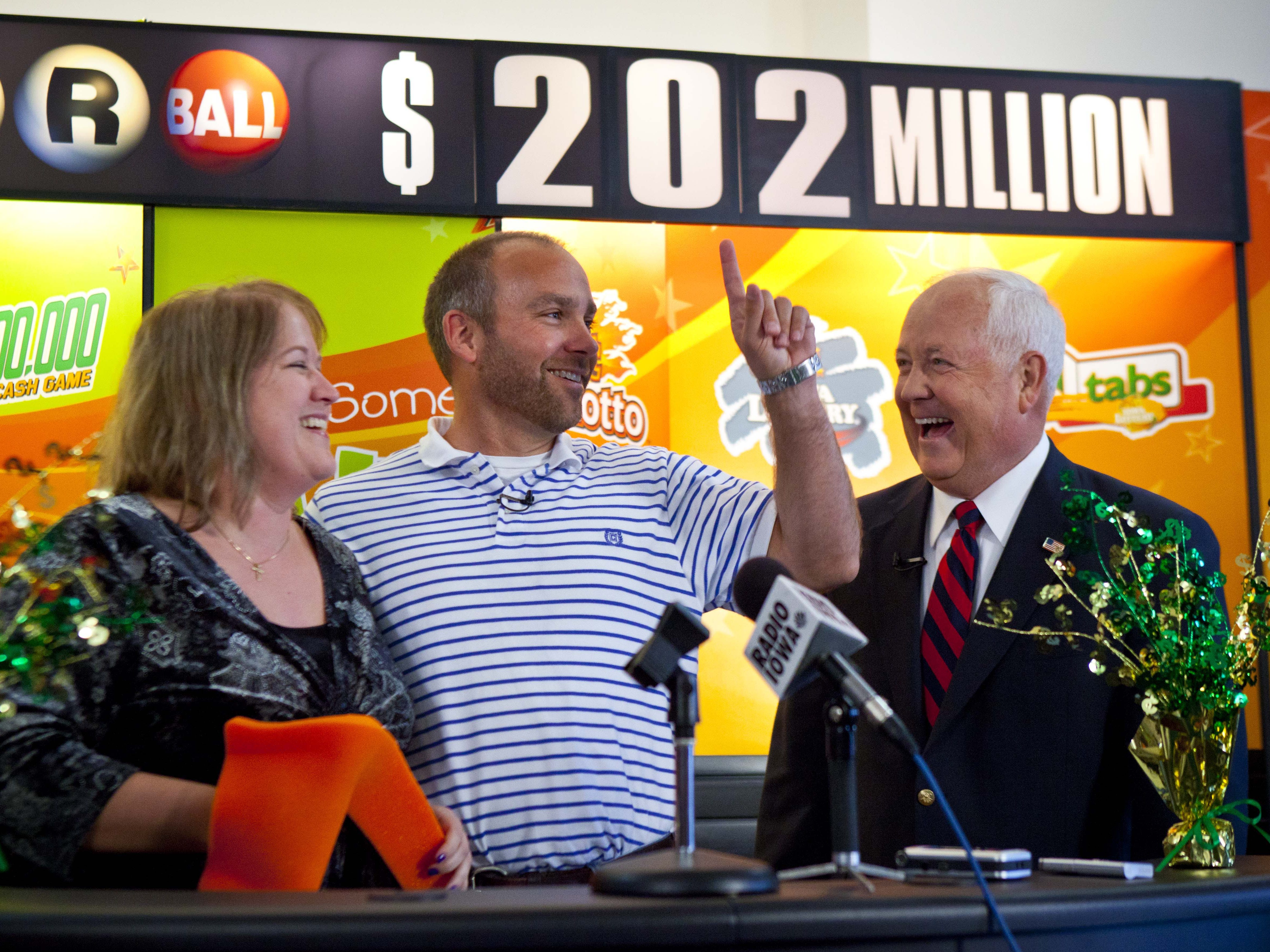 October 2012: Bondurant's Lohse family won a Powerball jackpot prize worth $202.1 million. Iowa Lottery CEO Terry Rich, right, congratulates the winners, Mary, left, and Brian, at a news conference after the couple claimed the prize.