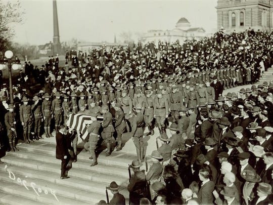 The funeral of Captain Harrison Cummins McHenry, the first Iowa officer killed in World War I.