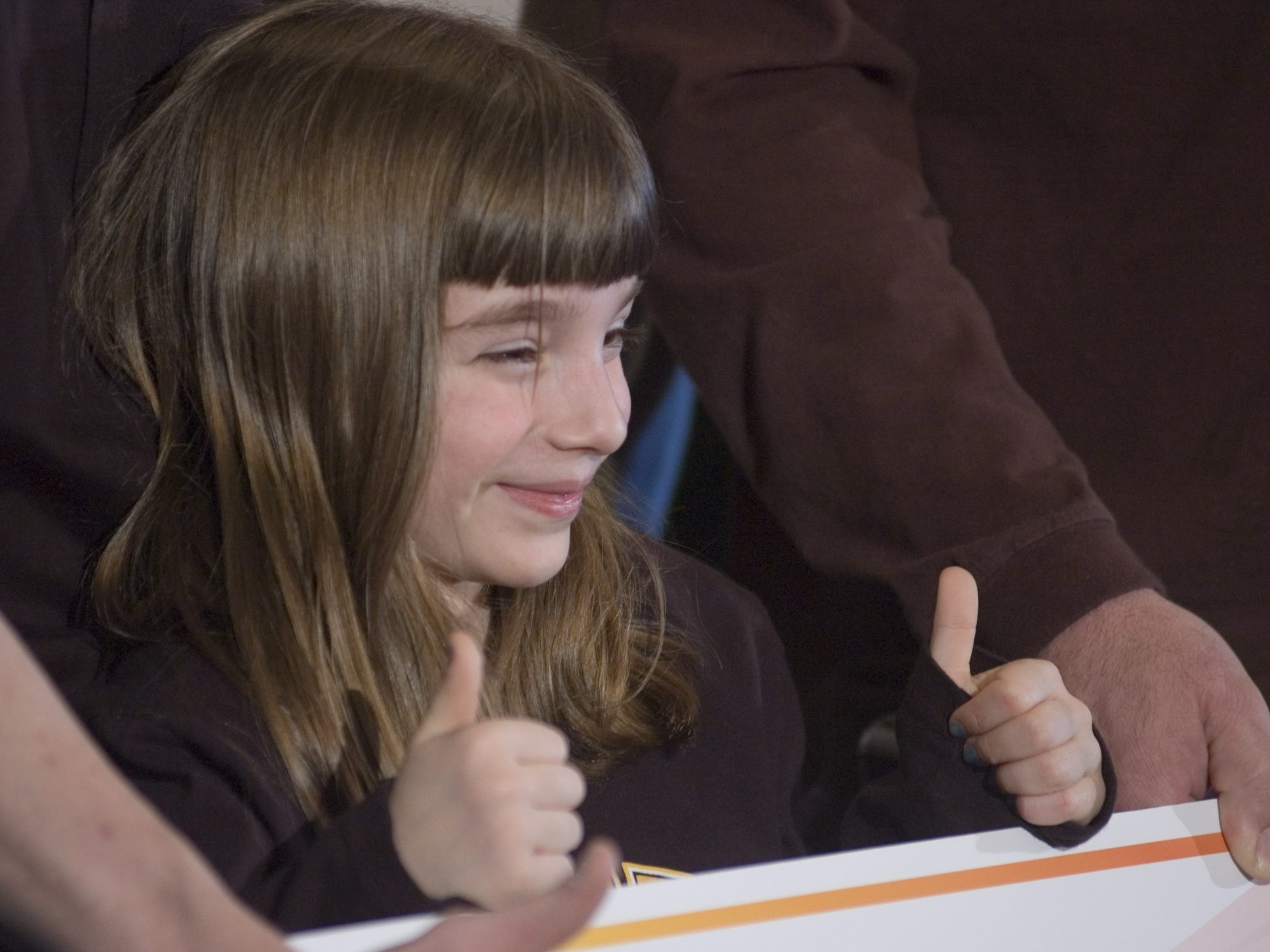 February 2007: Indianola's John Hall won a Hot Lotto prize worth $19.97 million. Here, Hall's 7-year-old daughter Jessica gives the thumbs-up sign at the news conference after her father claimed the prize.