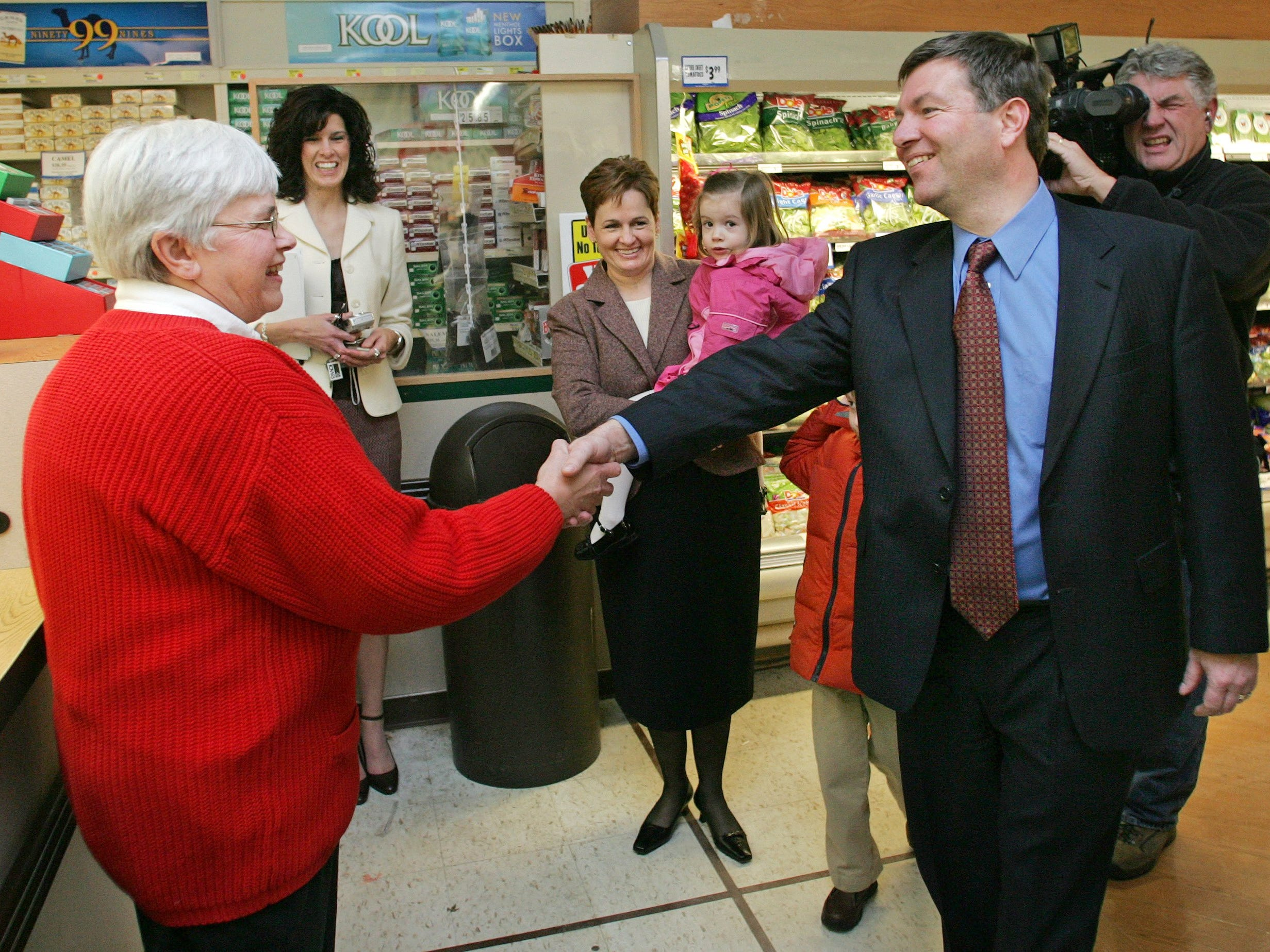 January 2006: Des Moines' Hugh Hawkins won a Powerball jackpot prize worth $113.2 million. Hawkins shakes hands with Dixie Upenieks, a Dahl's clerk at the Beaverdale store who helped validate Hawkins' winning lottery ticket when he came in to check his numbers and discovered he had won the $113.2 million Powerball jackpot, at the time the largest lottery prize won in Iowa.