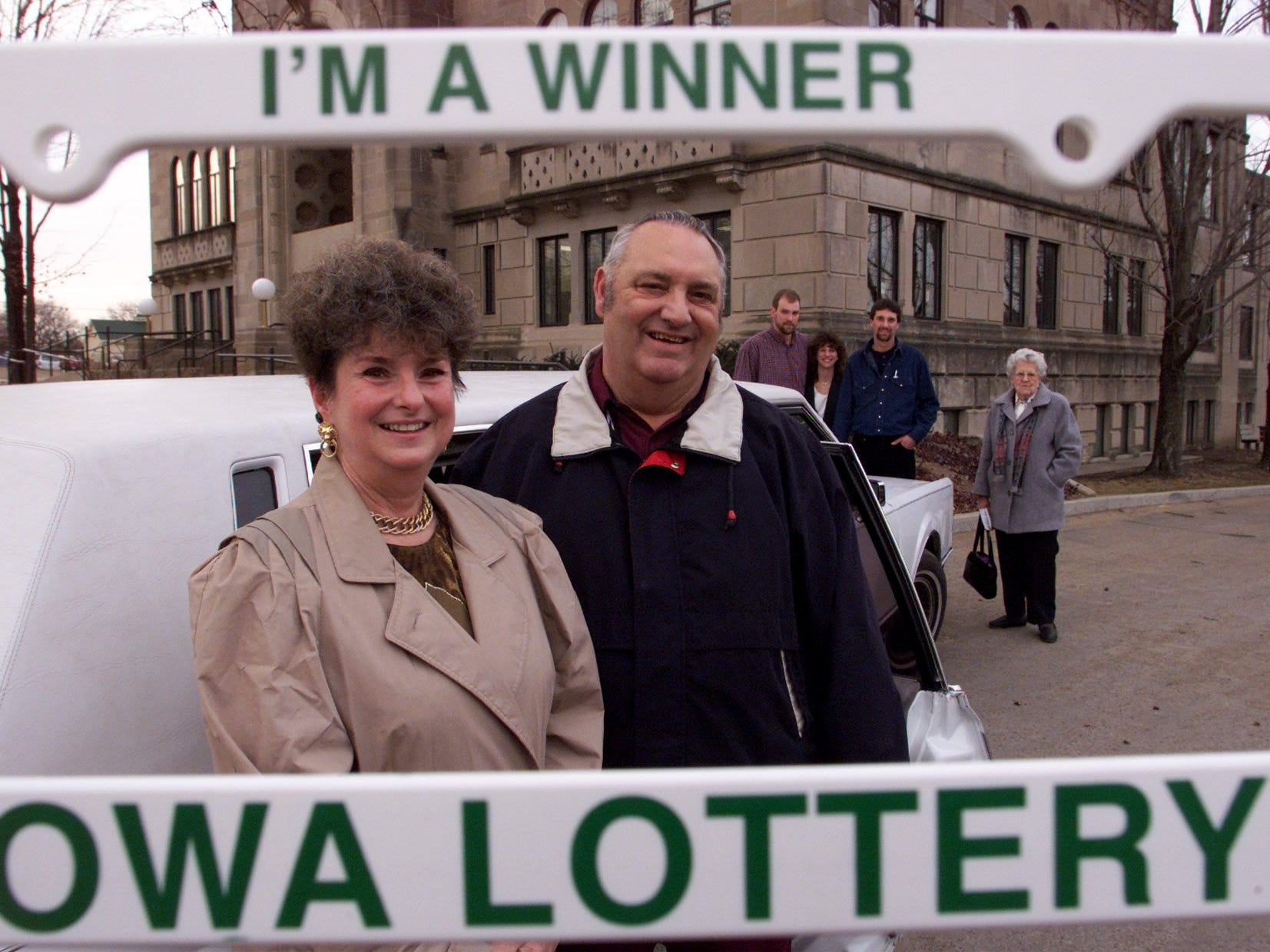 January 2000: Sabula's Haskin family won a Powerball jackpot prize worth $31.8 million. Sarann Haskin, left, and her husband Larry, are framed in a license-plate frame they were given — along with a huge Powerball check —  at Iowa Lottery headquarters in Des Moines.  At the rear are their children, left to right, James, Michelle and Michael, and Larry's mother, Violet Haskin.