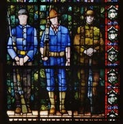 Grant Wood's stained-glass art of World War I soldiers located in Cedar Rapids.