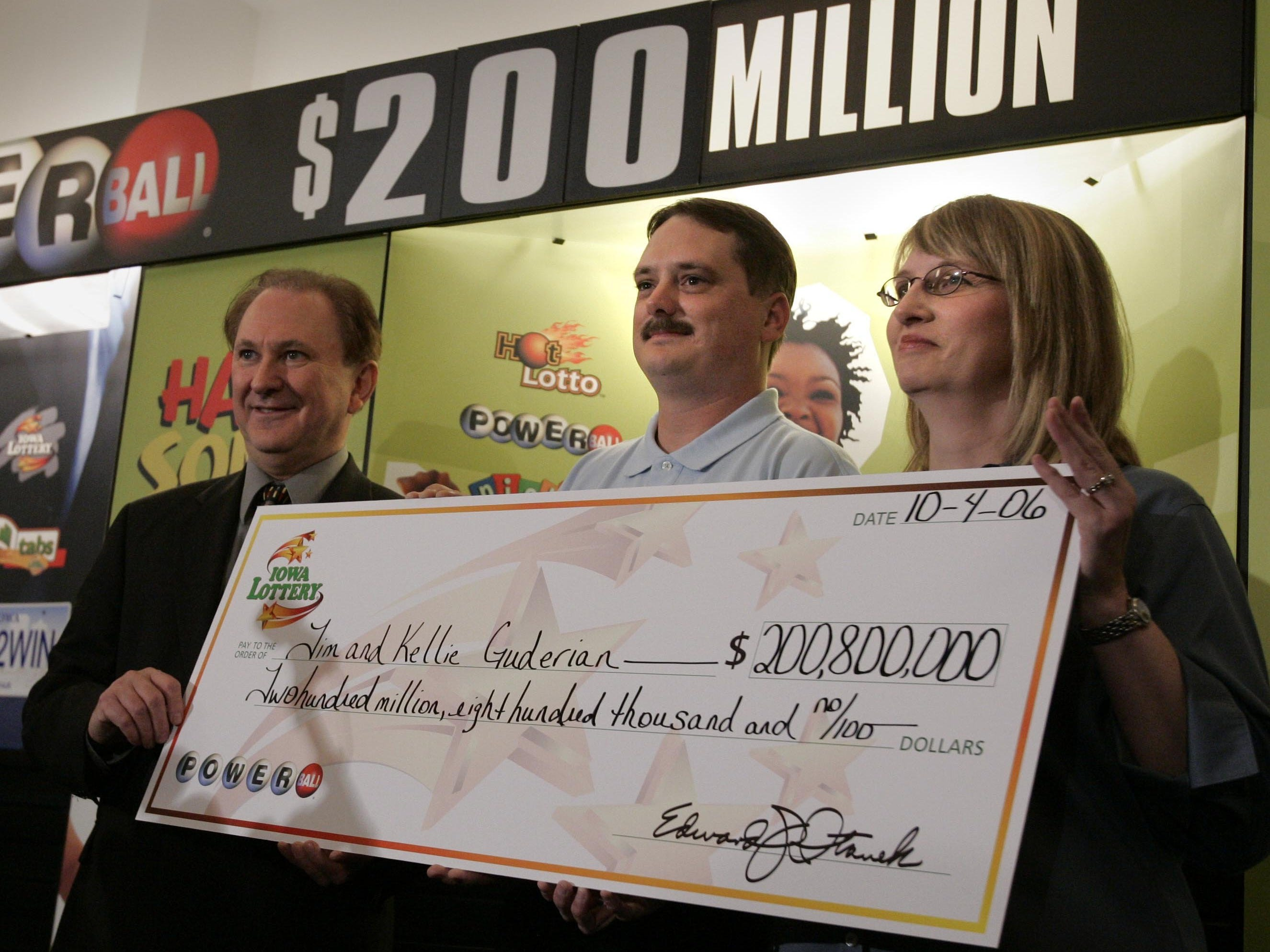 """October 2006: Fort Dodge's Timothy Guderian won a Powerball jackpot prize worth $200.8 million.  Here, Iowa Lottery's Edward Stanek, left, poses with Timothy and his wife, Kellie, after they claimed the prize.  """"We played the lottery about twice a month, but never expected to win,"""" Timothy said."""