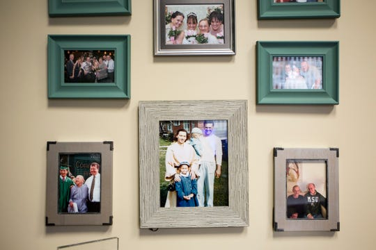 Edward Jones financial adviser Hilary Renno keeps her family in her thoughts with photographs in her office in Clarkston, Mich., Thursday, Oct 11, 2018.