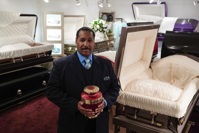 Stinson Funeral Home owner Rev. Curtis Williams stands inside the business on Meyers Rd. in Detroit.