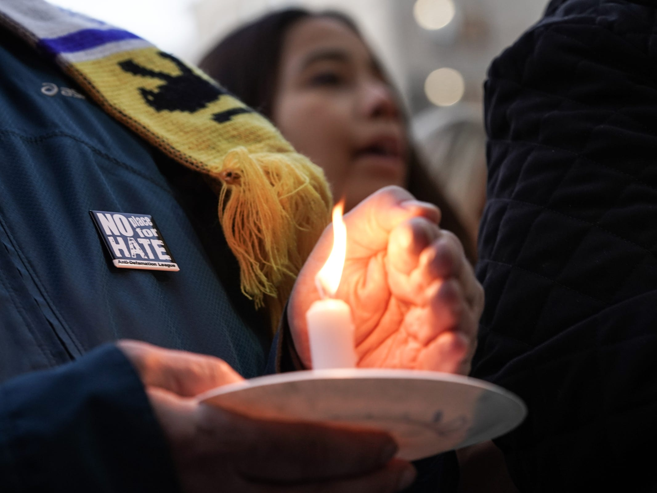 Harvey Leven of Farmington Hills holds a candle while singing with other community members during a vigil for the shooting victims killed inside the Tree of Life synagogue in Pittsburgh on Monday, October 29, 2018 at Capitol Park in downtown Detroit.