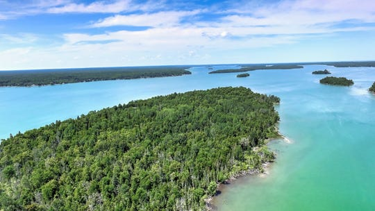 A private island and lodge on Grand Lake in Presque Isle is up for auction. Bids start at $250,000.