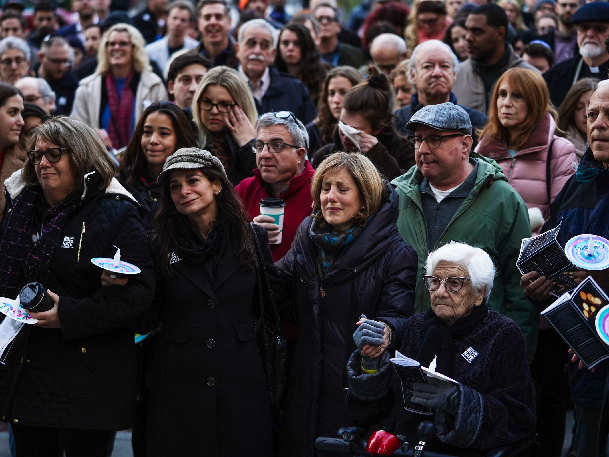 Community members come together during a vigil for the shooting victims killed inside the Tree of Life synagogue in Pittsburgh on Monday, October 29, 2018 at Capitol Park in downtown Detroit.
