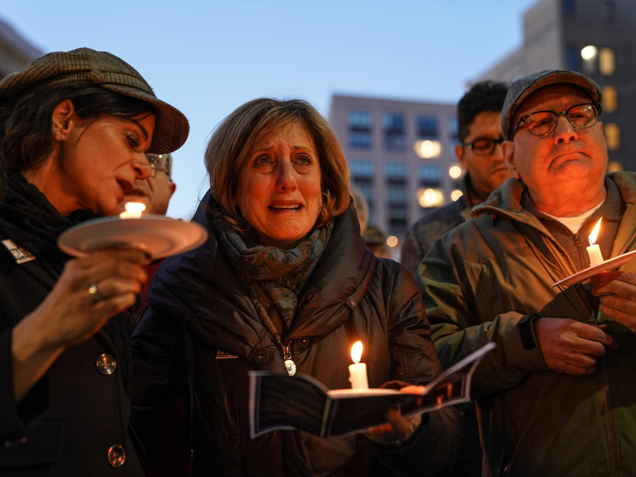 Shelly Podolsky (center) of Huntington Woods gets emotional while standing with her husband Arnold Podolsky (right) of Huntington Woods and Rachel Shere of West Bloomfield while listening to a speaker during a vigil for the shooting victims killed inside the Tree of Life synagogue in Pittsburgh on Monday, October 29, 2018 at Capitol Park in downtown Detroit.
