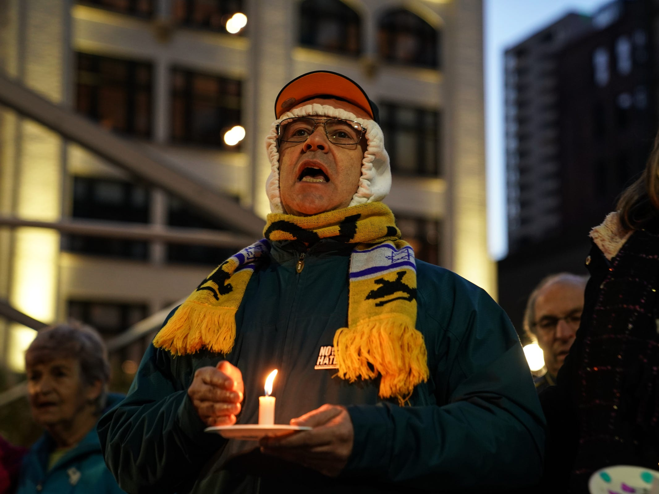 Harvey Leven of Farmington Hills sings along with other community members during a vigil for the shooting victims killed inside the Tree of Life synagogue in Pittsburgh on Monday, October 29, 2018 at Capitol Park in downtown Detroit.