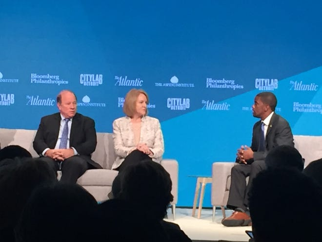 Detroit Mayor Mike Duggan (left) speaks with Seattle Mayor Jenny Durkan and St. Paul, Minn., Mayor Melvin Carter at CityLab Detroit on Monday Oct. 29, 2018.