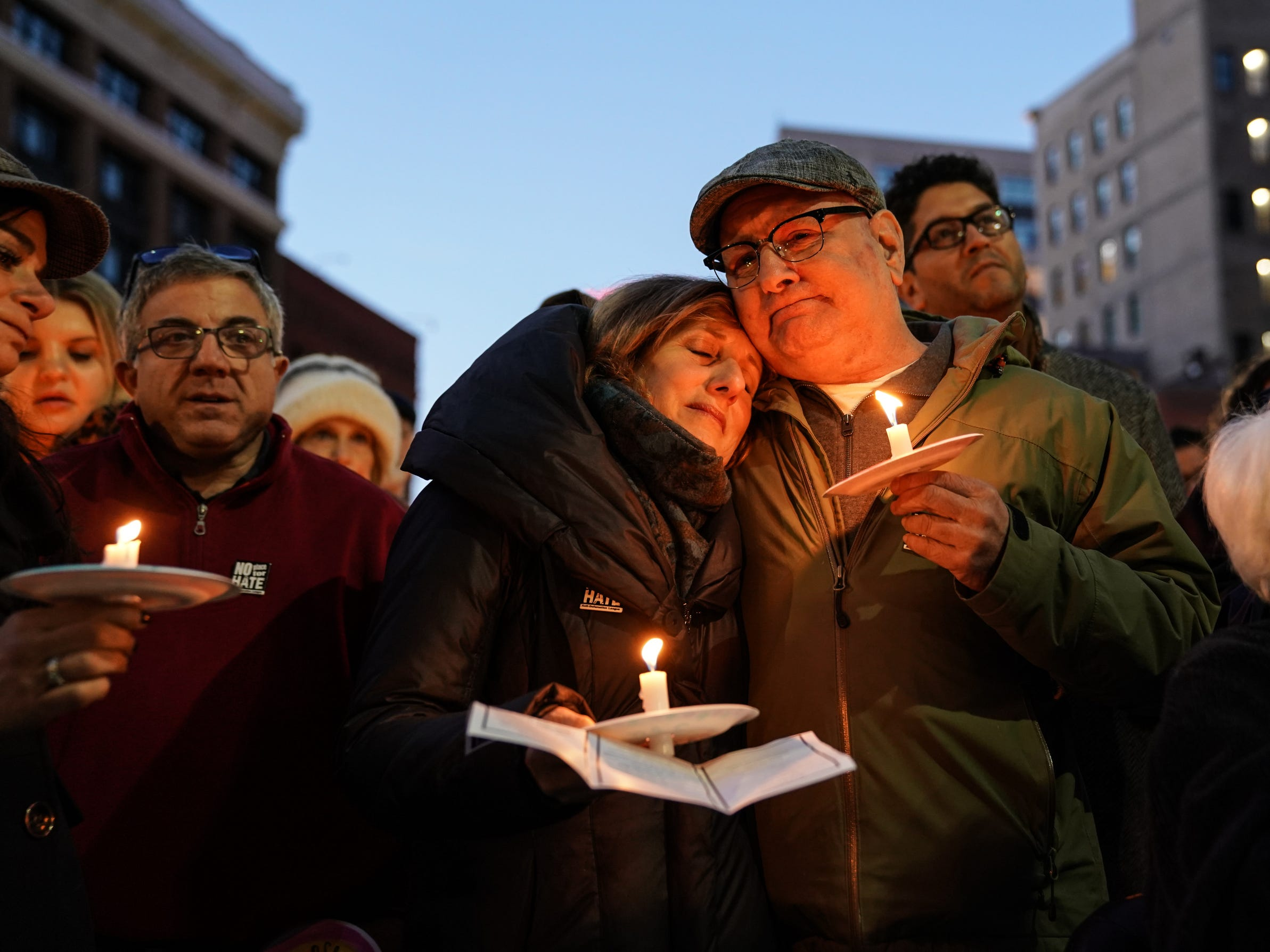 Shelly Podolsky is held by her husband Arnold Podolsky both of Huntington Woods while listening to a speaker during a vigil for the shooting victims killed inside the Tree of Life synagogue in Pittsburgh on Monday, October 29, 2018 at Capitol Park in downtown Detroit.